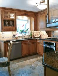 ideas decorate above kitchen cabinets smooth wooden countertop
