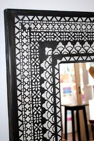 stencilled mirror frame using a selection of border stencils from