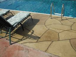 Pea Gravel And Epoxy Patio by Spraydeck Houston Tx Concrete Resurfacing Solutions