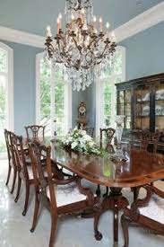 a supremely elegant crystal chandelier hangs above the hamilton