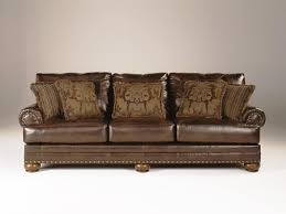 a review on natuzzi chesterfield and ashley furniture leather sofa