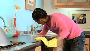 Cleaning Kitchen Sink by Man Cleaning Kitchen Sink With Sponge Young Attractive Man In New