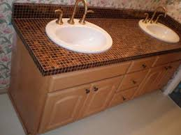 small bathroom vanity with undermount sink and granite countertops