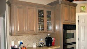 Staining Kitchen Cabinets Darker by Brown Stained Kitchen Cabinets With White Quartz Countertop