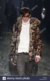 dark hair with grey models milan gucci menswear ready to wear model dark hair wearing orange