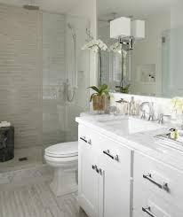 bathroom tile bathroom flooring glass doors chrome vanity light
