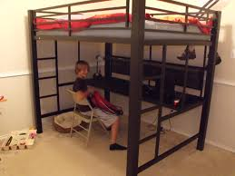 black metal full size loft bed with long desk underneath and two