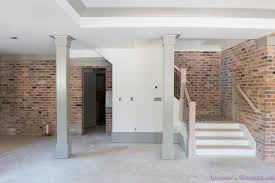 basement whitewashed brick limewash walls hardwood shaw flooring