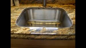 granite countertop kitchen cabinets faces stone backsplash tile