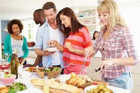 dinner host save money hosting a potluck dinner with friends priotime