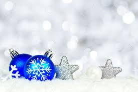 border of blue and silver ornaments in snow with twinkling