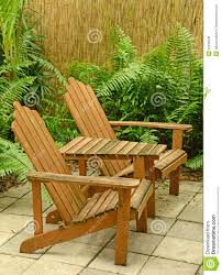wooden adirondack chairs in tropical backyard stock image image