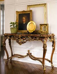 beautiful interior with french style carved console table luxury