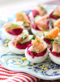 deviled eggs with beets and smoked salmon broken