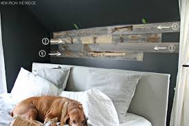 master bedroom reclaimed wood accent wall view from the