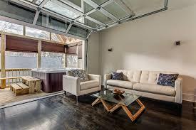 Loft Interior Sectional Glass Garage Door Transitional - Garage family room