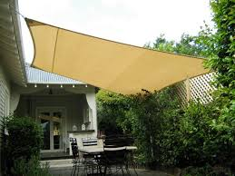 exterior yellow shade sail rectangle patio with iron table frame