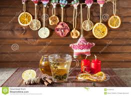 tea with spices honey cinnamon lemon and dried fruit