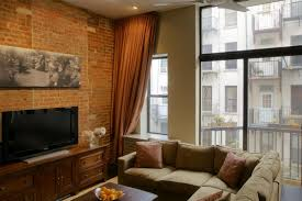 brick wall apartment living room living room apartment cozy design with exposed brick