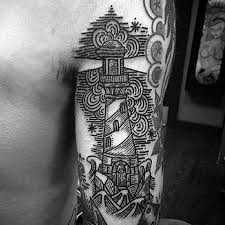 black and gray style small lighthouse tattoo on forearm