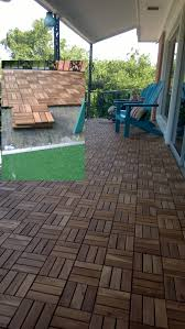 Ikea Outdoor Flooring by Covered The Many Layers Of Astroturf With Ikea Acacia Deck Tiles