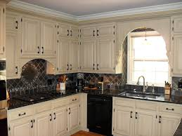 Kitchen Cabinet Makeovers - kitchen cabinet doors with faux iron inserts from faux iron