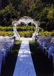 heart shaped arch decorated in white tulle silk wisteria plants