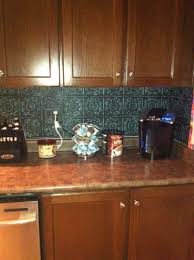 interior tin backsplash with varnished wood kitchen cabinet and