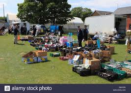 s yard boots sale car boot sale at hunstanton on a sunday morning stock photo