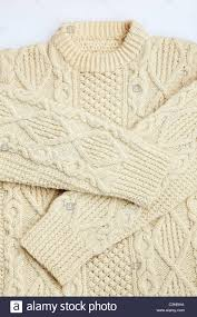 a traditional aran woolen sweater knitted in thick wool