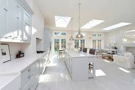 Open Plan Kitchen Living Room Lighting - light wooden floor kitchen transitional with white kitchen white
