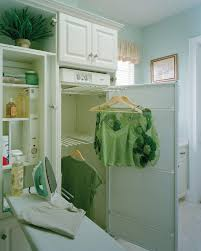 Laundry Room Hangers - miami ironing board cabinet laundry room traditional with built in