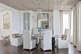 Linen Slipcovered Dining Chairs White And Beige Dining Room With China Cabinet Country Dining Room