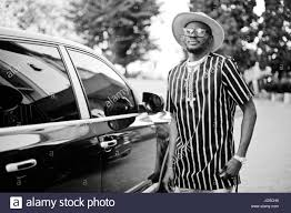 Cool Stock by African American Man Stylishly Dressed Opening The Door Of His