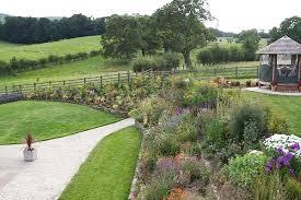Sloping Garden Ideas Photos Sloping Gardens Garden Designs For Large Gardens Park Farm Garden