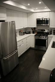 Grey Walls White Trim by First Home Renovation White Quartz Countertops Wall Wood And