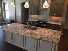 granite islands kitchen alaska white granite white cabinets island with glass tile