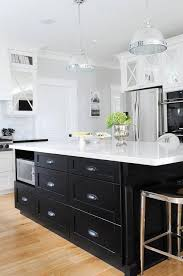 white kitchen with black island black kitchen island with black cup pull hardware transitional