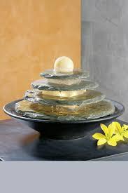 fontaine en pierre naturelle fontaine en pierre verte forme circulaire seliger spécialiste