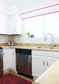 What Is The Best Way To Paint Kitchen Cabinets White The Best Way To Paint Your Cabinets Classy Clutter