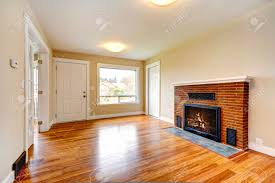 bright empty living room in soft ivory color with new hardwood