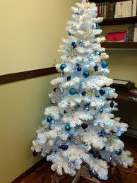 white and blue trees happy holidays