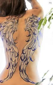 cross wings tattoo on back for women