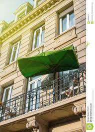 french balcony with sun protection umbrella stock photo image
