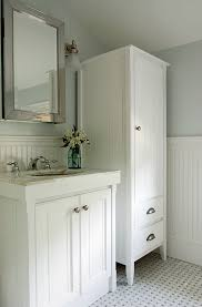 vanity with linen cabinet bathroom traditional with white vanity