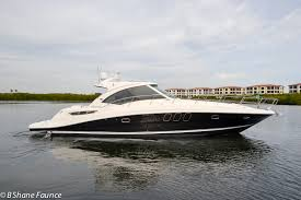 the sea ray 48 sundancer is a stunning hardtop express with