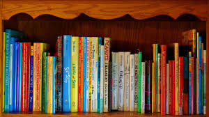 Bookshelf Books Child And Story Books Give The Gift Of Literacy During The Month Of November Learning
