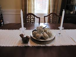sweet white candle dining room table centerpieces and white scarf