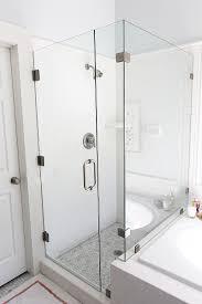 frameless glass shower next to tiled tub like the border around