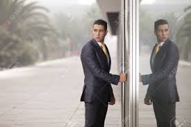 the glass door businessman open the office door and looking back with reflection